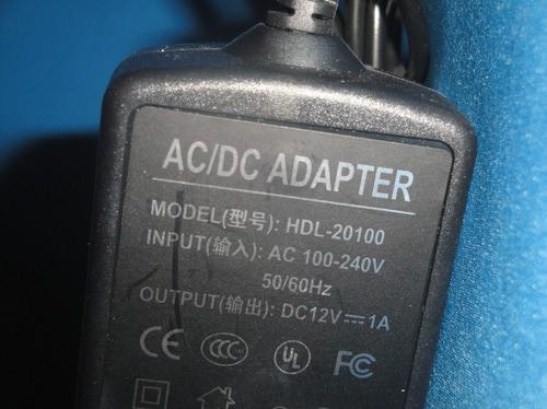 Блок питания для видеокамер HDL 20100 (фото, вид 1)